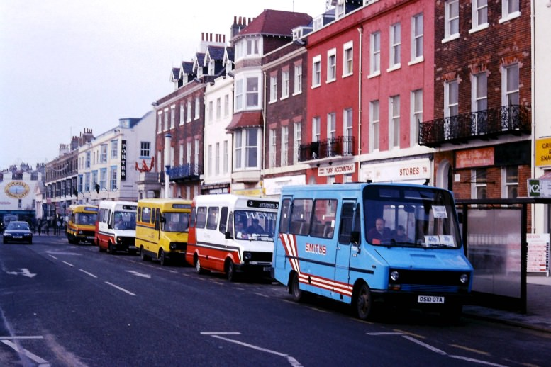 a line up of minibuses at Kings Statue Weymouth